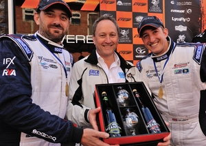 Flying Panther's Martin Robinson & Nick Williams are presented with a Meantime Bewery pack by Dale Power Solutions Chief Executive Tim Wilkins